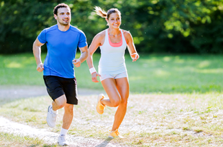 man and woman running together outside