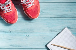 sneakers and a notebook on the floor